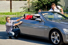 Male thief trying to steal handbag. From the car Stock Photography