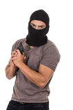 Male thief wearing mask and holding gun isolated. Male thief wearing mask and holding gun pointing up isolated on white Royalty Free Stock Photos