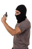 Male thief wearing mask and holding gun isolated. Male thief wearing mask and holding gun side view isolated on white Royalty Free Stock Images