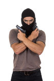 Male thief wearing mask and holding guns isolated Stock Image