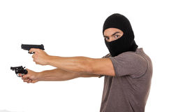 Male thief wearing mask and holding guns isolated Royalty Free Stock Photo