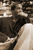 Male in thought. Thinking young man sepia Royalty Free Stock Images