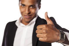 Male thumb up. Smiling African businessman showing thumb up Stock Images