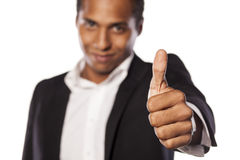 Male thumb up. Smiling African businessman showing thumb up Stock Photo