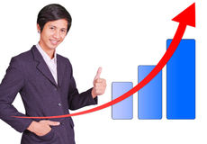 Male is thumbs up successful of graph. Male is thumbs up successful up graph Royalty Free Stock Image