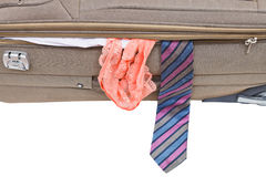 Male tie and female panties from suitcase Royalty Free Stock Photography