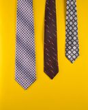 Male ties isolated on a yellow background. Male ties isolated on a yellow background Royalty Free Stock Image