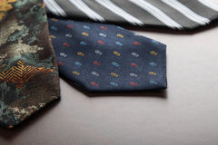 Male ties on table Stock Photos