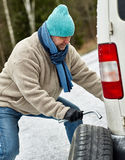 Male and tire exchange Stock Photo
