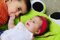 Male toddler and baby girl. Portrait of male toddler and baby girl with happy expression Royalty Free Stock Images