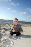 Male toddler playing on beach Stock Images