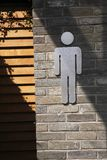 Male toilet entrance. Indicated with an international symbol for toilets Stock Photography
