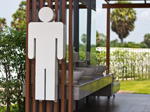 Male toilet sign. Male toilet sign white with wood Royalty Free Stock Photos