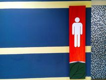 Male toilet signage. Photo of a male toilet signage Stock Photo