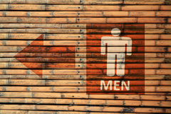 Male Toilet Signs. Male Toilet Signs on brown bamboo wood wall Stock Photos