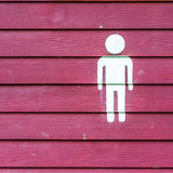 Male toilet signs. In red background Royalty Free Stock Photos