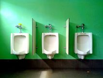 Male Toilet urinals. Photo of male toilet urinals Stock Photos