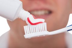 Male With Toothbrush And Toothpaste Royalty Free Stock Photos