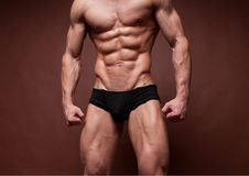 Male torso. Muscled male torso with strong abs Stock Photo