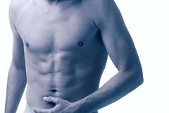 Male torso isolated on white. Cross-processed Royalty Free Stock Photography