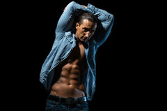 Male Torso. Muscular Man Showing Off With his Abs , Isolated On Black Background Royalty Free Stock Image