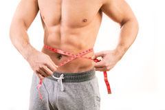 Male torso and red tape measure. On white background Stock Photos