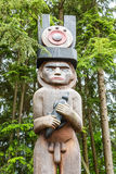 Male Totem in Woods Stock Photo