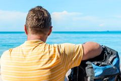 Male tourist admires the sea. View from the back Royalty Free Stock Photography