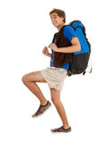 Male tourist with backpack. Smiling male tourist with backpack, full length, white background Royalty Free Stock Photos