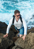 Male tourist. Male tourist with backpack climbing mountains Royalty Free Stock Image