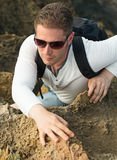 Male tourist. Male tourist with backpack climbing mountains Royalty Free Stock Photography