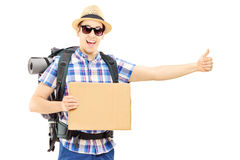 Male tourist with backpack hitchhiking Stock Photo