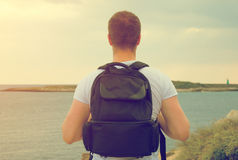 Male tourist with backpack. Stock Photos