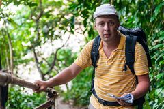 Male tourist with a backpack. In the jungle resting Royalty Free Stock Images