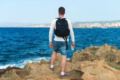 Male tourist with backpack. Male tourist with backpack standing near the sea. Place for your text Stock Photos