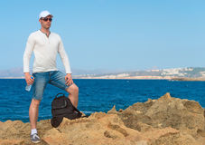 Male tourist with backpack. Male tourist with backpack standing near the sea. Place for your text Stock Photo