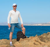 Male tourist. Male tourist with backpack standing near the sea. Place for your text Stock Image