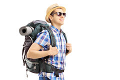 Male tourist with backpack walking. Isolated on white background Royalty Free Stock Image