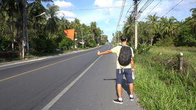 Male tourist backpacker hitch-hiking in Asia stock video footage