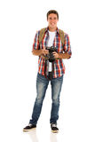Male tourist camera. Handsome male tourist with a camera on white background Royalty Free Stock Images