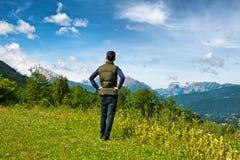 Male tourist enjoying the scenic Bavarian alps Stock Photo