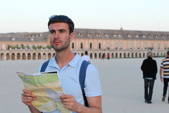 Male tourist holding map with copy space.  Royalty Free Stock Image
