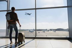 Male tourist looking at flight Stock Image