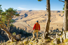 Male tourist looking at panoramic autumn landscape Stock Photos