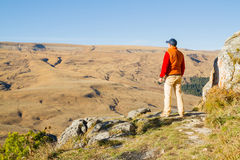 Male tourist looking at panoramic autumn landscape Stock Photography