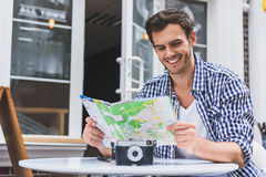 Male tourist making plan of trip Royalty Free Stock Images
