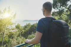 Male tourist. Male tourist with big rucksack on the hill Stock Photography