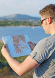 Male tourist with map. On vacation Stock Photo