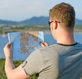Male tourist with map. On vacation. From the back Stock Photography