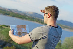 Male tourist with map. Male tourist with map on vacation. From the back Stock Photos
